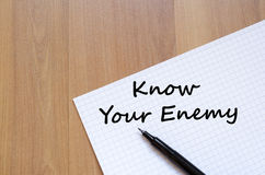 Know your enemy write on notebook. Know your enemy text concept write on notebook with pen Stock Image