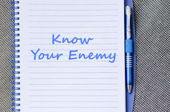 Know your enemy write on notebook. Know your enemy text concept write on notebook with pen Stock Photo