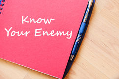 Know your enemy write on notebook. Know your enemy text concept write on notebook with pen Stock Photos