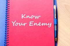 Know your enemy write on notebook. Know your enemy text concept write on notebook with pen Royalty Free Stock Images