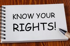 Know Your Rights. Written on notebook page with pen aside on wooden desk. Business Concept stock photo