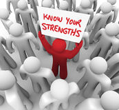 Know Your Strengths Man Holding Sign Abilities. Know Your Strengths words written on a sign and held by a different or unique person with a competitive advantage Royalty Free Stock Images