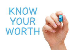 Know Your Worth. Hand writing Know Your Worth with blue marker on transparent wipe board royalty free stock image