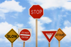 Knowing When to Quit. Road signs sitting on a sky background, knowing when to quit Stock Image