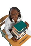 Knowledge. Female African-American Student by stack of books Royalty Free Stock Image