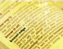 Knowledge. Close up of an English language dictionary, the word knowledge focused. Vintage yellowed paper effect. Raw format available Stock Photos
