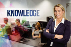 Knowledge against computer teacher smiling at camera with arms crossed Stock Photos