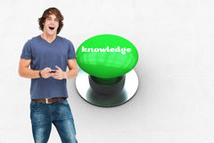 Knowledge against digitally generated green push button Royalty Free Stock Image
