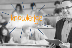 Knowledge against lecturer standing in front of his class in lecture hall Stock Photography