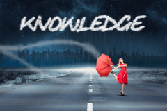 Knowledge against road leading out to the horizon Stock Photo