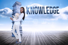 Knowledge against stack of books against sky Royalty Free Stock Photo