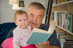 Knowledge and book. Happy family. Essential values. stock photos
