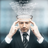 Knowledge concept. Abstract image of pensive businessman with mathematical formulas loading into his head.Knowledge concept royalty free stock photography