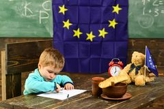 Knowledge concept. Child draw at table with eu flag on class chalkboard, knowledge. Hungry for knowledge. Knowledge is. Power. First grade Royalty Free Stock Image