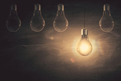 Knowledge concept. Empty chalkboard with glowing light bulb. Knowledge concept. Mock up, 3D Rendering Stock Images
