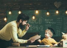 Knowledge concept. Man teacher read book to little boy in school, knowledge. Child get knowledge through education
