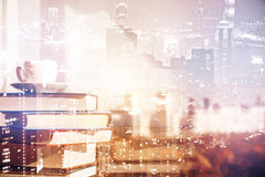 Knowledge concept. Pile of books and coffee cup on abstract city background with copy space. Knowledge concept. Double exposure royalty free stock photos