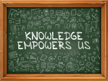 Knowledge Empowers Us - Hand Drawn on Green Chalkboard. Stock Photo
