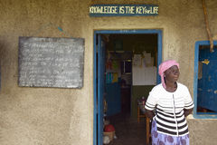 Knowledge is the key for life sign and teacher in front of school house near Tsavo National Park, Kenya, Africa Royalty Free Stock Image