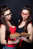 Knowledge Is The Key - Sexy Smart Twins Royalty Free Stock Photo