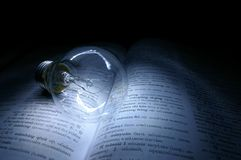 Knowledge is Light. A bulb on book, representing the idea of learning and knowledge
