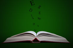 Knowledge is a power. Open book with black letters going out Stock Photos
