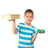 Knowledge is power - boy with book and weight. Portrait of a kid Isolated on white background - white blond boy weighing a large book in one hand and a small Stock Photography