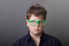 Knowledge is power. Boy in green glasses Stock Photos