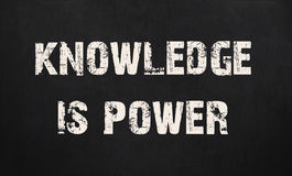 Knowledge is power written on a chalkboard.  Stock Images