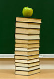Knowledge and red apple Royalty Free Stock Photography