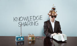 Knowledge is sharing concept with vintage businessman and calculator. At office Stock Photo