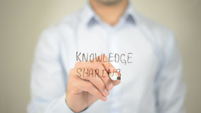 Knowledge Sharing , man writing on transparent screen royalty free stock photography