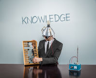 Knowledge text on blackboard with businessman stock photo