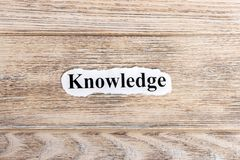 knowledge text on paper. Word knowledge on torn paper. Concept Image Royalty Free Stock Image