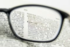 Knowledge word close up, view through nearsighted lens glasses Royalty Free Stock Photography
