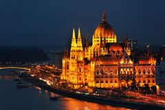 The beautiful facade of Hungarian Parliament Building of Budapest at night. Known as the Parliament of Budapest is a notable landmark of Hungary and a popular stock image