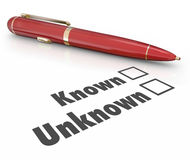 Known Vs Unknown Check Boxes Pen Filling Out Form Answer Questio. Known and Unknown words beside check boxes on a form, document or questionairre and a red pen Stock Images