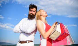 He knows how make her happy. Girl hold bunch shopping bags gifts birthday anniversary holiday. Generosity is important. Trait for man. Hipster confident stan stock images