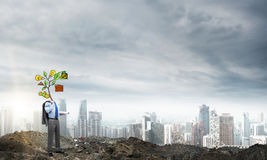 He knows how to earn money. Faceless businessman outdoor with drawn growth concept instead of head Stock Images