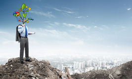 He knows how to earn money. Faceless businessman outdoor with drawn growth concept instead of head Stock Photography