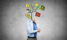 He knows how to earn money. Faceless businessman in room with drawn growth concept instead of head Stock Photos