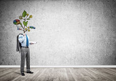 He knows how to earn money. Faceless businessman in room with drawn growth concept instead of head Royalty Free Stock Photo