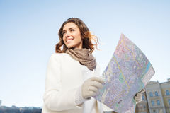 She knows the right direction. Beautiful young women looking int Stock Photos