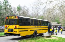 Knox County School bus picking up students in the Cades Cove Ca. Horizontal shot of School Kids On a Field Trip in the Smoky Mountains Tennessee Royalty Free Stock Photography