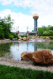 Knoxville Sunsphere (vertical). Sunsphere, bridge and water, and rocks in Knoxville Tennessee Stock Image