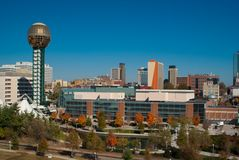Knoxville Tennessee. Skyline of Knoxville Tennessee on a clear day. Worlds Fair park showing the Sunsphere, convention center, office buildings, and man-made Royalty Free Stock Image