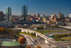 Knoxville TN. Skyline of Knoxville Tennessee showing freeway system, business district, and Sunsphere (center -background). Lower left is the  Women's Basketball Royalty Free Stock Photography