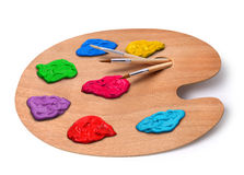 Künstlerpalette mit Farben und Pinseln Lizenzfreies Stockfoto