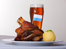 Knuckle. Of pork with potato dumpling on a plate Royalty Free Stock Photo