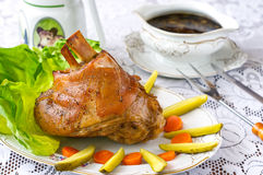 Knuckle of pork. With caramel beer sauce Royalty Free Stock Photo